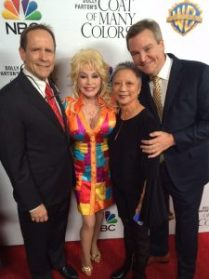 On the red carpet at the premiere screening of Dolly Parton's Coat of Many Colors at Grauman's Egyptian Theater in Hollywood, Wednesday evening, December 2. L to R: Hudson Hickman, Producer; Dolly Parton, Maysie Hoy, Film Editor; Sam Haskell, Executive Producer.