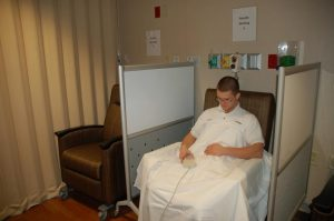 ER patients awaiting test results can relax in recliners in a comfortable waiting area at the new emergency room. Baptist employee Hunter Yeatman is posed as a patient in this photo.