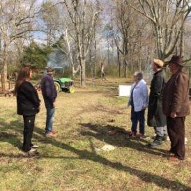 Looking at area where ground for the garden is being cleared are Lisa Galloway, Marie White, Pat James, Eugene Stockstill and Michael Hale