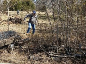 Myrtle Chief of Police, Jim White, Lending a hand with the clean up as a volunteer Friend of the Master Gardeners.
