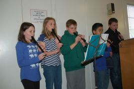 NAES students perform for Rotary Club using Carnegie Link recorders