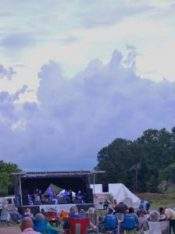 Heavy rain clouds, like these photographed when The Dukes first took the stage, threatened throughout the Saturday evening Levitt concert, but no rain fell before everyone went home.