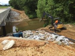 Workmen finished grading Wednesday on the downstream side of the new bridge that carries Martintown Road across the Little Tallahatchie River.