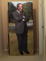A cardboard cut-out of himself, given to Stewart at his retirement, stands watch in his home.