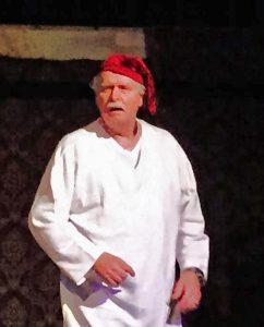Ebenezer Scrooge (Bill Gault) ponders his visions