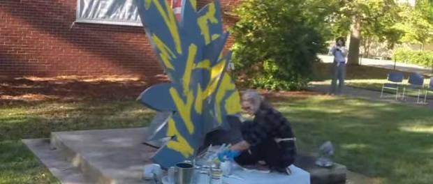 Swamp Flower being repainted by Mia Kaplan