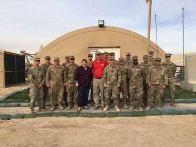 Kelly with soldiers in Kuwait