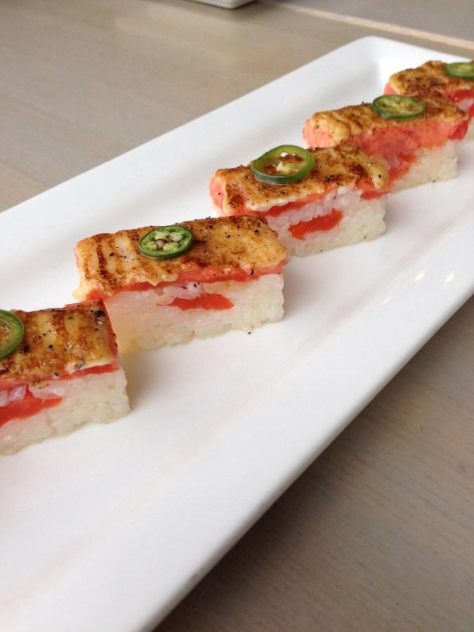 Salmon Oshi Sushi - pressed BC wild sockeye salmon, jalapeno and Miku sauce.