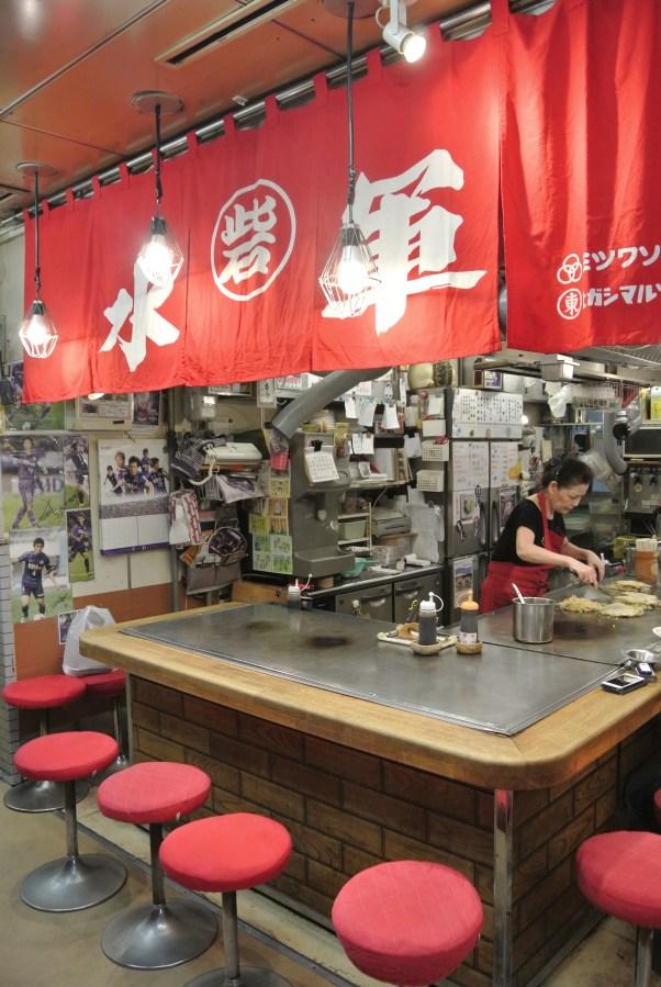 One of the many stalls in Okonomimura that specialize in making Okonomiyaki.