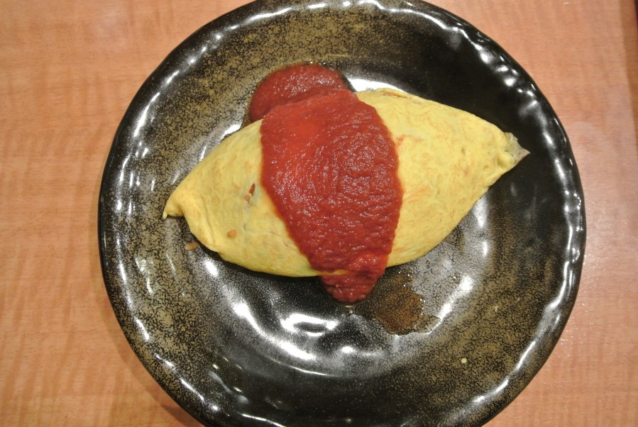 The omurice dish at Mollette, topped with tomato sauce.