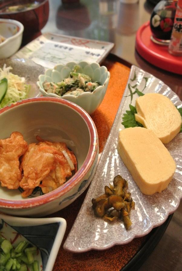 Sides of kamoboko (fish cakes) and tamagoyaki (egg).