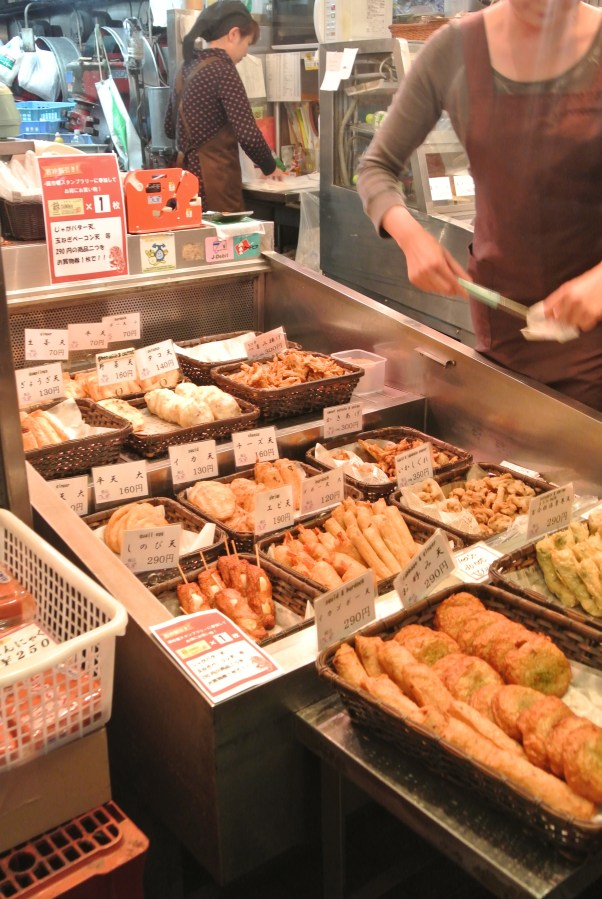 A wide selection of different fried fish cakes and balls.