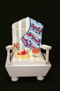 One of five clever needlepoint chairs from Cheryl Schaeffer