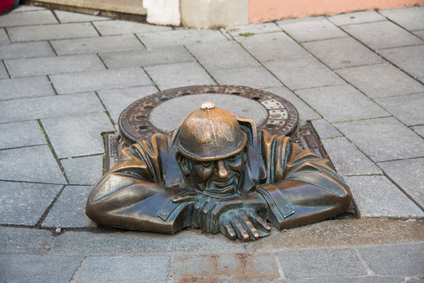 famed Cumil the sewage worker statue in the old town of Bratislava