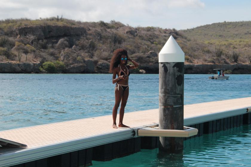 Nneya Standing on Dock Curacao Richards