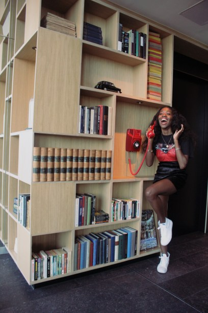 laughing on phone citizenM Nneya Richards