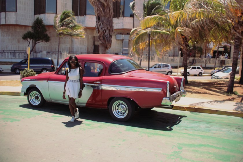25 Red Car at National Hotel by Nneya Richards