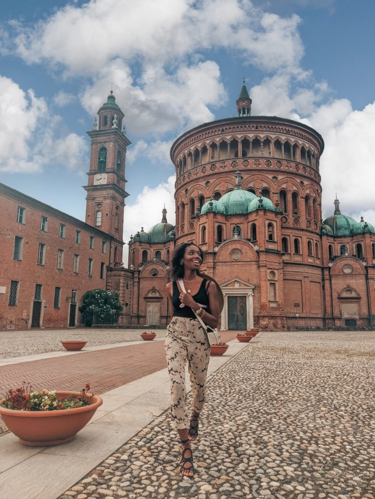 Girl in front of Red Brick Rotunda of a Basilica