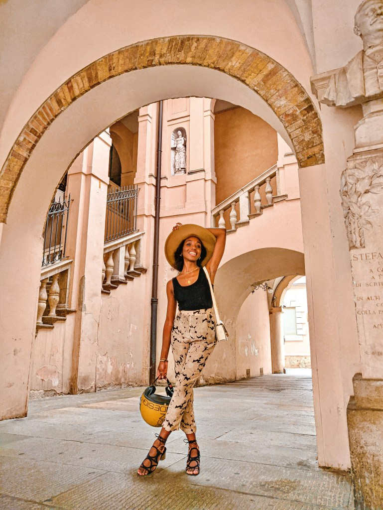 Girl in Palazzo archways of Crema