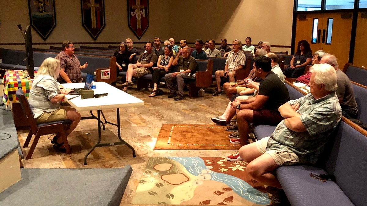 wide shot of listening audience