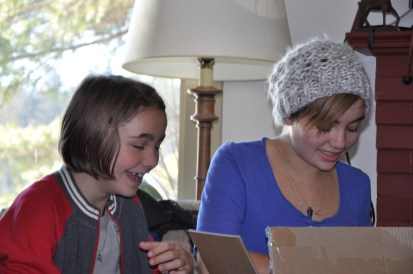 Opening their present from me.
