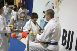 Coach Joe promotes one of the Little Ninjas to the next belt.