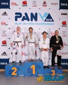 Master Roberto wins gold at the Pan American Championship in his adult brown belt heavy division in 2013