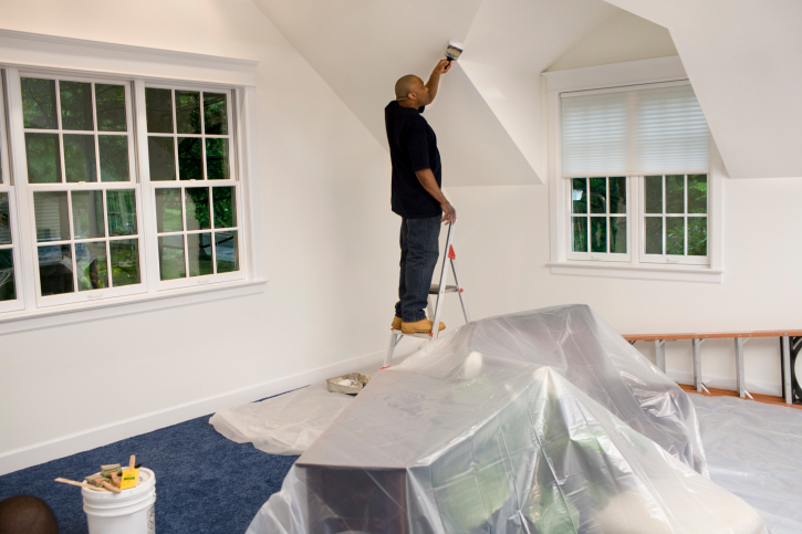 man painting home