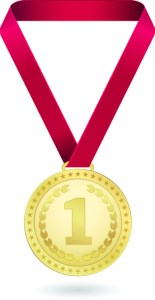 Gold Medal engraved with !, on red ribbon
