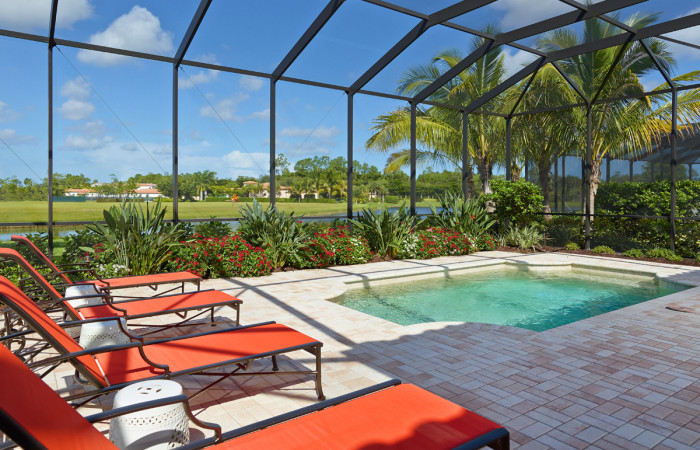 Screened pool and lanai of The Angelica model at Mediterra by London Bay Homes custom luxury homes   photo: londonbayhomes.com