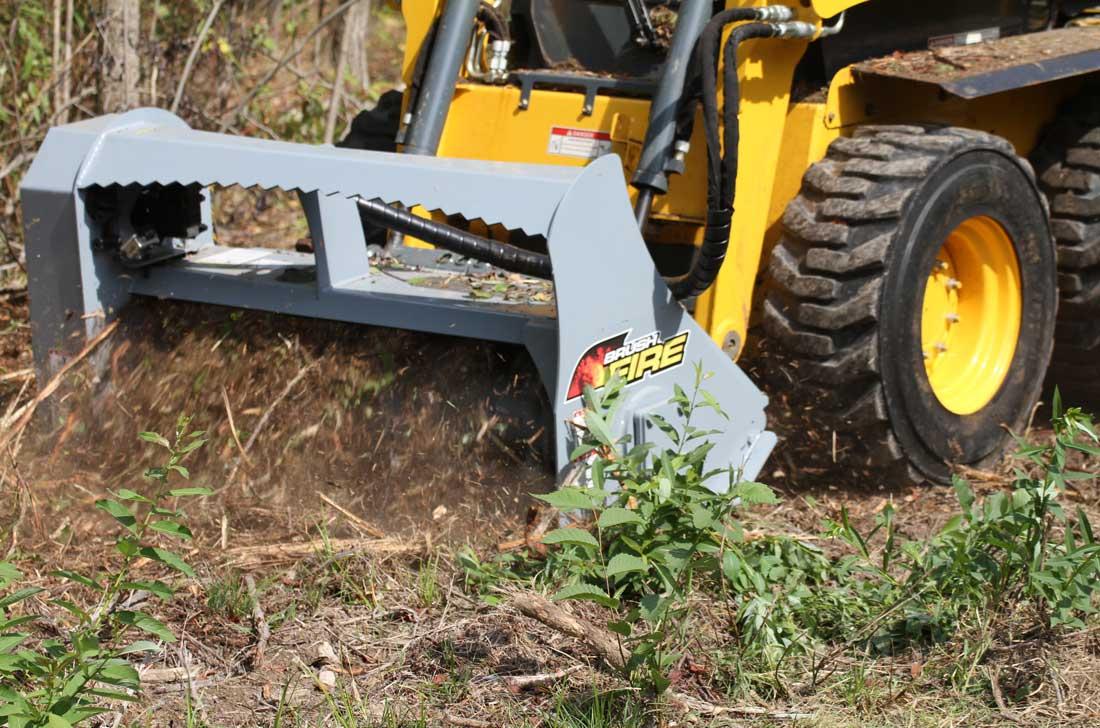 Baumalight-skidsteer-mulcher-clearing-a-brush – Naples Elite