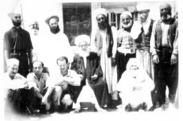Shaykh Abdullah ad-Dagehestaniwith murids in Damascus.  Shaykh Nazim is to the right of Grandshaykh and  Shaykh Hussein is to his left.
