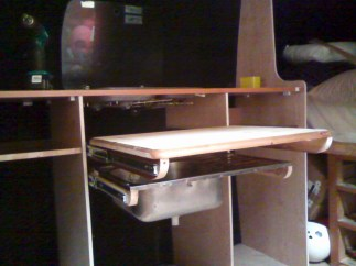 Slide out table and sink under the stove