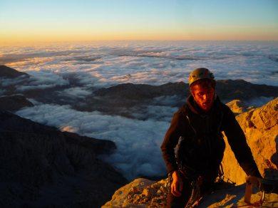 Seb on the summit ridge at sunset