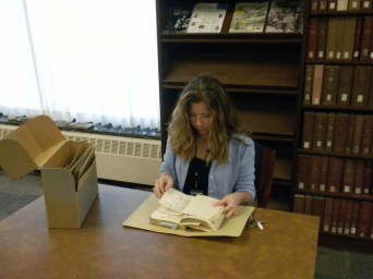 Tammy Kelly processing the records of Bess Truman.