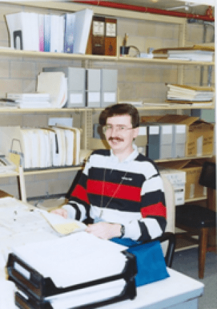 This is me in December of 1993 shortly before the Center for Electronic Records moved to College Park. At this point I had my own touch tone phone on my desk! (Photo by Linda Henry)