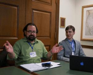 Robert Fernandez (left) speaks at WikiConference USA