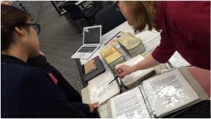 Carol Swain from NARA's Special Media Records Division, Motion Picture Branch showing the Historypin team research aids for the newly digitized WWI films at NARA's Research Room in College Park, MD.