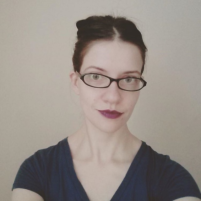 a photo of laurel green with purple lipstick and wearing glasses