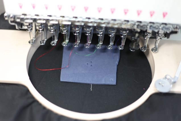Layer with filler material. Make some holes in the material to enable the conductive sides to touch when pressed.