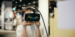 game-based learning (girl with VR headset)