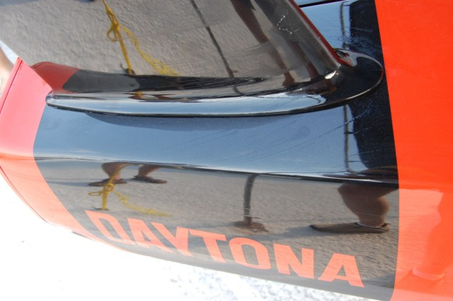 The oil dots on to of the rear quarter panel streaked away from the base of the rear wing pylon, indicating a small zone of airflow separation. This is another example of junction flow separation.