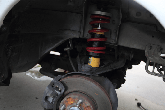 Start by measuring the static dimension from the top of each wheel to the fender edge. Then, with the car up on four jack stands, remove the springs and anti-roll bar links at all four corners.