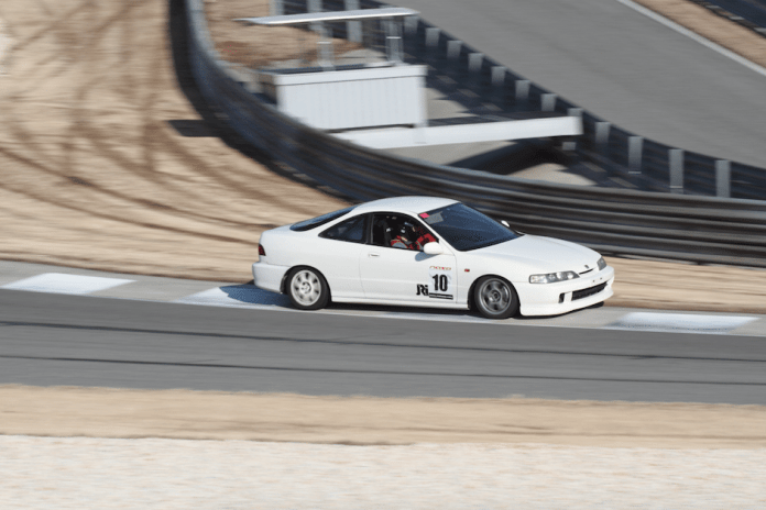 If you read the label on the helmet and the sticker on the door, you can see the image isn't flipped. Robert Paszkiewicz's 1997 Honda, not Acura, is a right-hand drive car, one of two JDM cars at Barber that weekend.