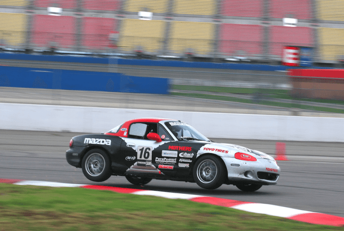 Ken Saward took the win in the wet on Saturday by just .077 seconds.