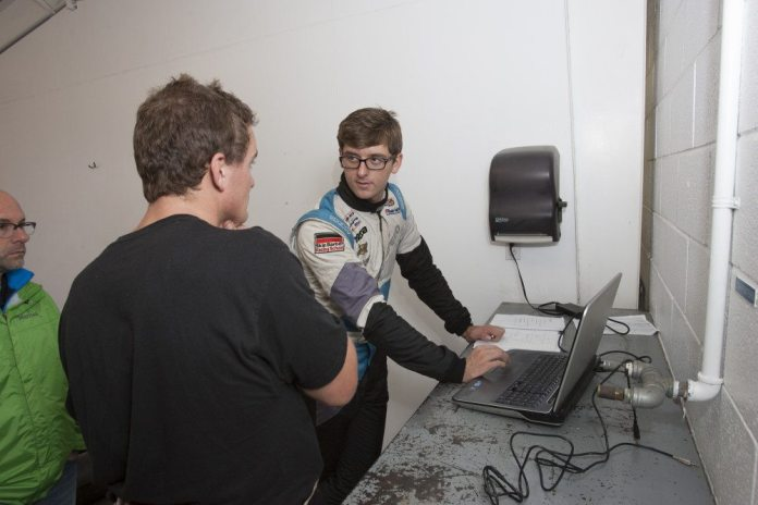 Mazda factory driver Kenton Koch goes over data with finalist Joey Jordan.