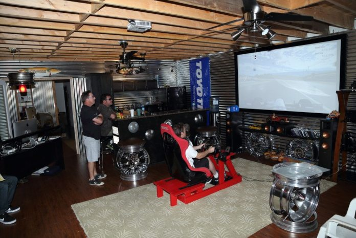 In addition to a shop out back, In The Doghouse Garage also has an office up front and man cave in between, complete with a bar and racing simulator setup.