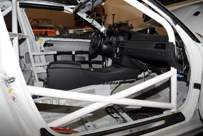 After paint, ITDG begins installing the roll bar padding.