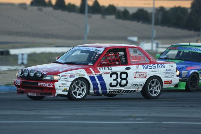 Our Nissan Sentra SE-R does wheel-to-wheel battle at the 25 Hours of Thunderhill, where two transponders are required. We mounted the primary rechargeable transponder as far forward as possible and the hard-wired secondary transponder toward the rear of the car.