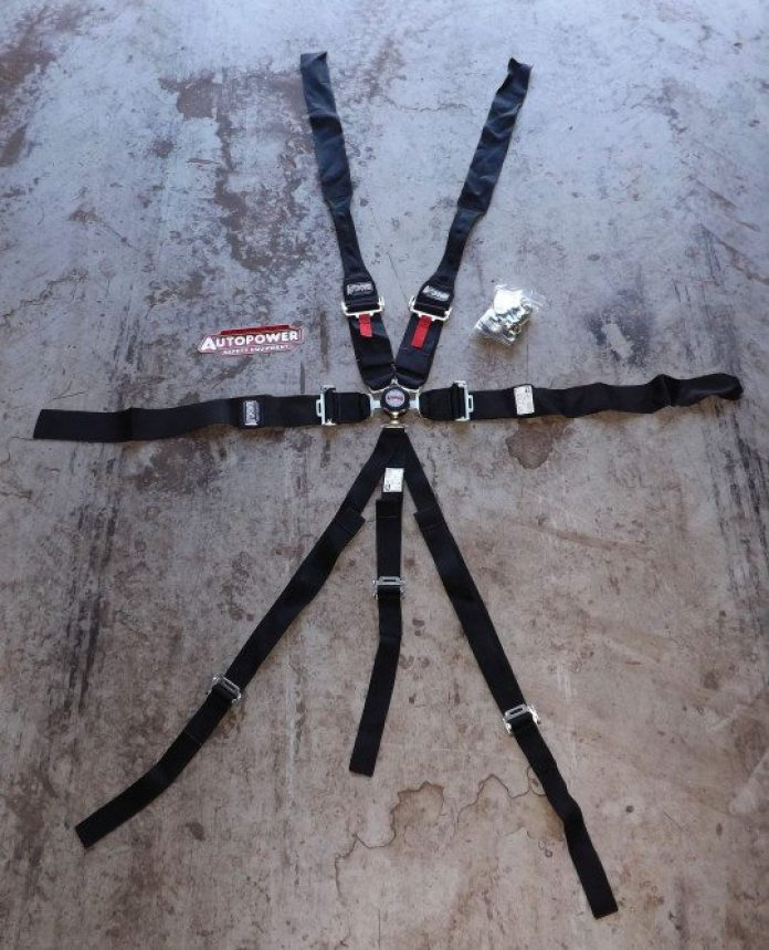 Autopower is known for its massive catalogue of bolt-in and weld-in roll cages, but its safety equipment doesn't stop there. Autopower offers numerous configurations of harnesses, including a seven-point system with HANS shoulder belts as seen here. Autopower also will do custom orders, like this system, with red flaps to easily loosen belts and a three-point sub belt.